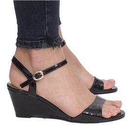 Black patent sandals on a delicate Queen wedge heel