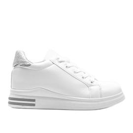 Katherine's white sneakers