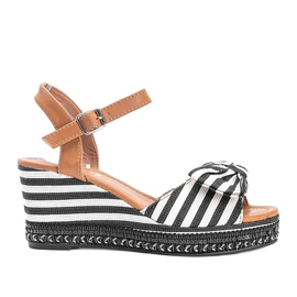 Black and white wedge sandals from Dulce