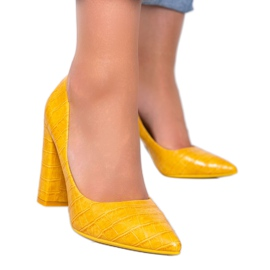Mustard pumps on a post with This Way snakeskin motif yellow