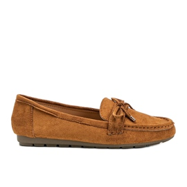 Brown loafers with a Deonte bow