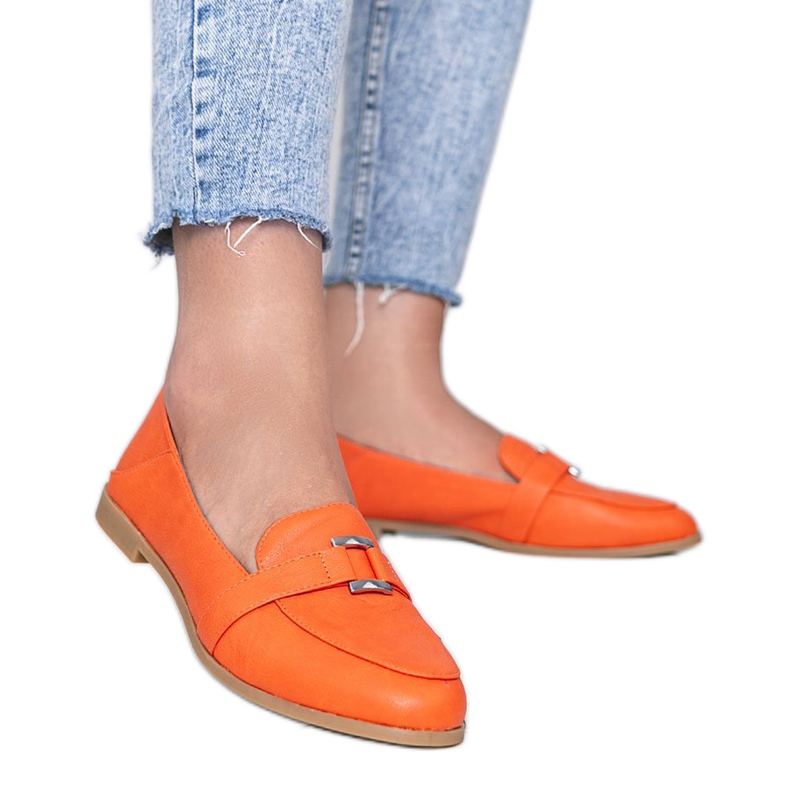 Orange moccasins decorated with an Island Paradise buckle