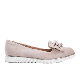 Beige loafers with a Nausura bow