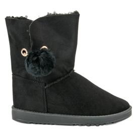 Black Mukluki With a sheepskin coat