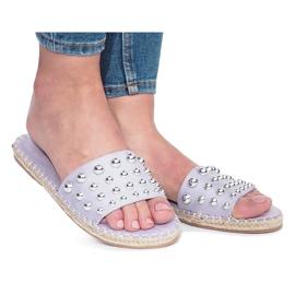 Violet flip-flops with Mocate studs