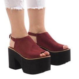 Burgundy sandals on a massive B8290 brick