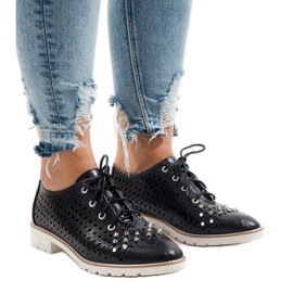 Black openwork shoes with G-106-2 studs
