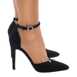 Black pumps on a button fastened M1L3223-13