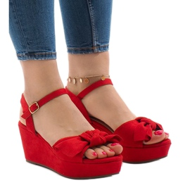 Red wedge sandals with F055 bow