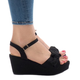 Black wedge sandals with F055 bow