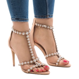 Nude sandals on a pin with 8296-Y studs