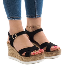Black sandals on wedge heel XL104