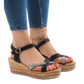 Black sandals on the WS8816 platform