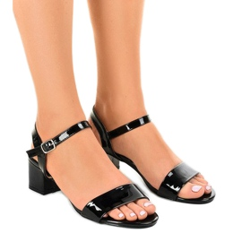 Black sandals on the Qla-93 lacquered post