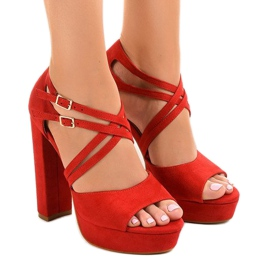 Red sandals on the suede stiletto D09