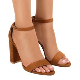 Brown elegant sandals on the LA-106 post
