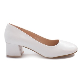 Brown White pumps on the Renda post