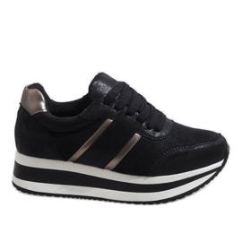 Black sneakers on the platform 99-09