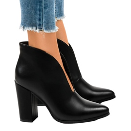 Black slip-on boots with cut-outs on the RB38P post