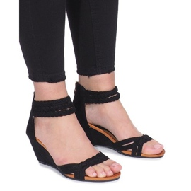 Black sandals on a delicate Desun wedge
