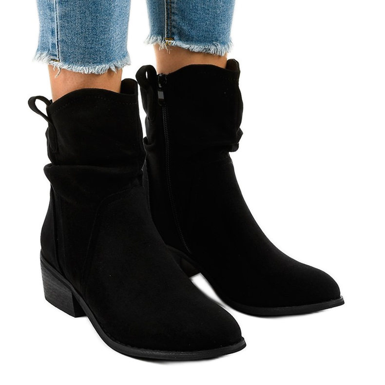 Black suede boots with a 3893 zip