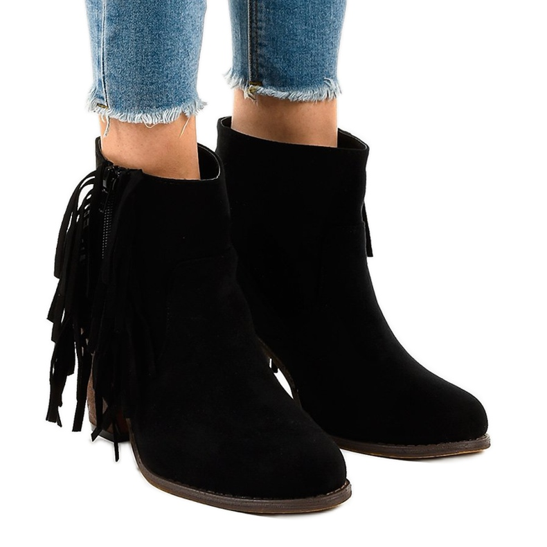 Black suede boho boots on a post FY8333