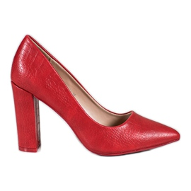 Diamantique red Pumps On A Bar