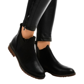 Black flat ankle boots with an elastic W360