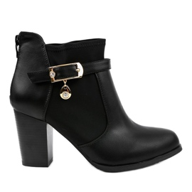 Black boots on the post of a gold pendant F205