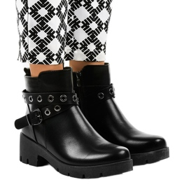 Black flat-heeled ankle boots with a 9996-2 buckle