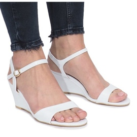 White varnished sandals on a delicate Queen wedge heel brown