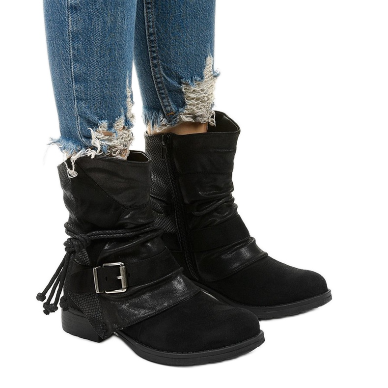 Black ankle boots with a buckle and a decorative Coord upper