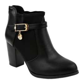 Black boots on the post of a gold pendant F205 1