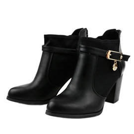Black boots on the post of a gold pendant F205 2