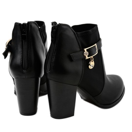 Black boots on the post of a gold pendant F205 3
