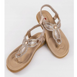 Gold flat sandals decorated with CT-29 golden 7