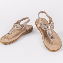 Gold flat sandals decorated with CT-29 golden 8