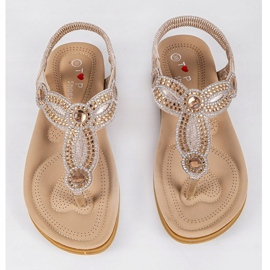 Gold flat sandals decorated with CT-29 golden 9
