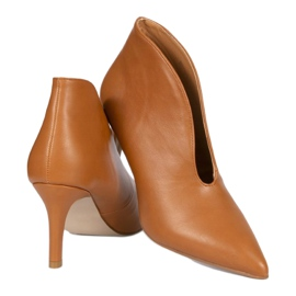 Brown slip-on boots with cutouts on the NS126P Pu pin 1