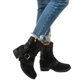 Black ankle boots with a buckle and a decorative Coord upper 1