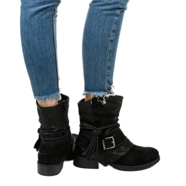 Black ankle boots with a buckle and a decorative Coord upper 3
