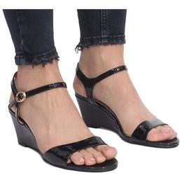 Black patent sandals on a delicate Queen wedge heel 1