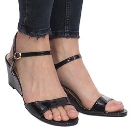 Black patent sandals on a delicate Queen wedge heel 2