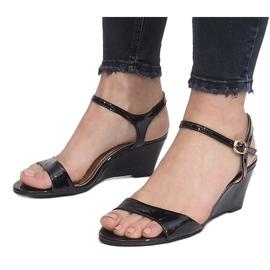 Black patent sandals on a delicate Queen wedge heel 4