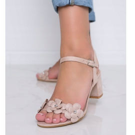 Beige sandals on a post with Little Havana flowers 1