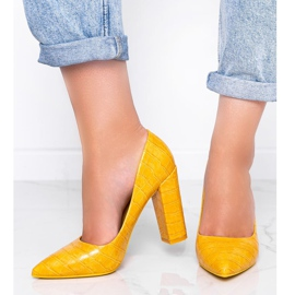 Mustard pumps on a post with This Way snakeskin motif yellow 1