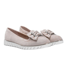 Beige loafers with a Nausura bow 1