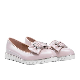 Beige lacquered loafers with a Nemesise bow 1